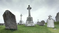 Christian religion Celtic Cross Crosses in old Graveyard Static Stock Footage