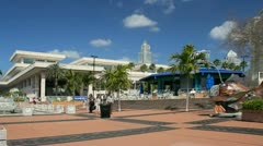 People walking on Tampa riverwalk away from Convention Center - stock footage