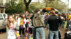 School bus on street with traffic of Mardi Gras Stock Footage
