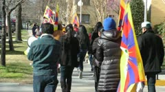 Tibetans March from rear in Washington, DC Stock Footage