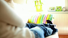Woman on a Sofa in Uncomfortable Position Stock Footage