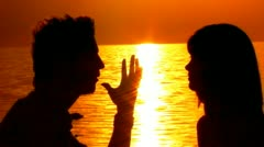 Young Couple Talking By Shining Golden Sunset On Sea Close Up Stock Footage