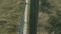 Rack focus, fence to barb wire Stock Footage