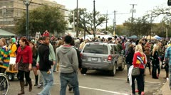 Cars attempting to drive through Mardi Gras traffic Stock Footage