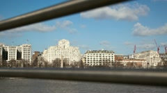 Timelapse track of clock on building in London from Millennium Bridge wide Stock Footage