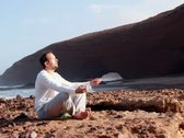 Stock Video Footage of Man meditating on the rocks, Legzira beach NTSC