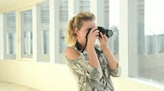 Girl with camera Stock Footage