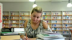 Girl in the library - stock footage