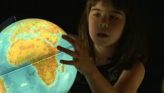 GIRL LOOKING AT GLOBE Stock Footage