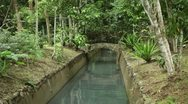 Garden with water canal through it. Stock Footage