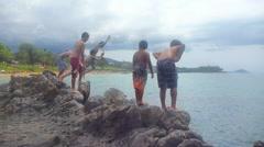 Hawaiian Kids Jumping into Ocean 1 Stock Footage