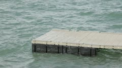Lake floating dock rough water P HD 9136 - stock footage