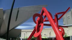 Red Sculpture to Denver Art Musuem pan Stock Footage