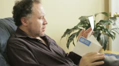 Man reads a Notice from the IRS. - stock footage