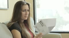 A woman reads a Final Notice from the Bank. Stock Footage