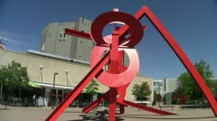 Red Medal Sculpture in front of the Denver Art Museum - stock footage