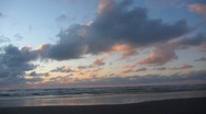 Stock Video Footage of Driving Along Beach During Ocean Sunset 1