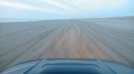 Stock Video Footage of Car Driving on Sandy Beach Point of View