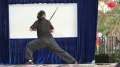 Woman Kung-Fu Sword Form Stock Footage