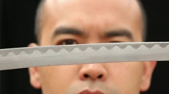 Extreme Close Up Sword Draw with Eyes Stock Footage