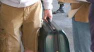 Man carrying a luggage Stock Footage