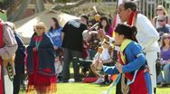 Stock Video Footage of Pow Wow Elder and Youth