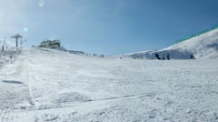 Skiers on a piste Stock Footage