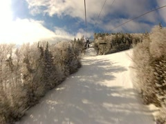 Fast ski lift ride to top of mountain - stock footage