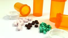 Drugs and Medicine; capsules, pills and tablets rotate clockwise; 2 Stock Footage