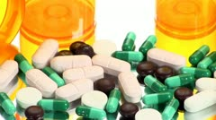 Drugs and Medicine; capsules, pills and tablets on mirror - stock footage