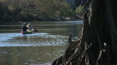People, Couple paddleing canoe on Ocklocknee River in Florida - stock footage