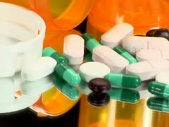 Drugs and Medicine; capsules, pills and tablets on mirror; 3 Stock Footage