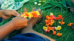Flower Weaver-Building a Leis in Yap Stock Footage