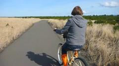 Boardwalk Bicyclist - stock footage