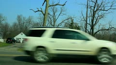 Tornado debris hanging from trees along roadway Stock Footage