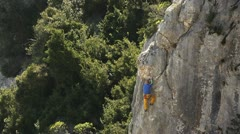 Young man training and climbing on cliff Stock Footage