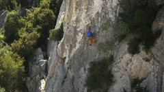 Male athlete exercising and climbing on rocks Stock Footage