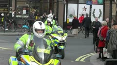 Stock Video Footage of London Police Motorcycles rapidly depart