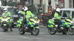 London Police motorcyclists  direct traffic Stock Footage