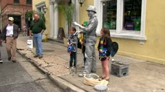New Orleans street entertainer posing with people Stock Footage