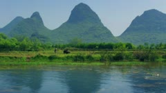 Yangshuo, China - bamboo rafting IX Stock Footage