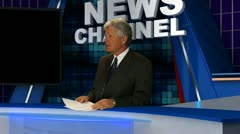 Newsman at desk 4 - stock footage