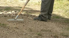 Cleaning gravel on a path - stock footage