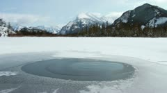 Mount Rundle and water spring 01 Stock Footage