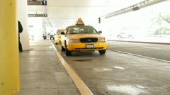 Young womenl catching a cab at the airport HD9327 Stock Footage