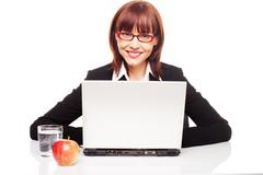 Businesswoman with healthy snack Stock Photos