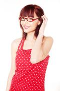 Red haired woman wearing red dress with polka dots Stock Photos