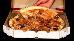 Hands of the people take to pizza, which have right before delivered Stock Footage