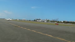 Executive jet arriving to airstrip and airport terminal Stock Footage