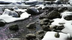 Some snow melting at the river Stock Footage